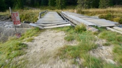 It crosses a wooden bridge in fleeing over mountain river 37b Stock Footage