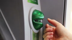 Detail of human hand insertion and removal of a credit card at an ATM. woman's Stock Footage