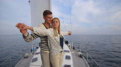 Young couple having romantic time on a yacht in the sea - stock footage