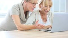 Senior women websurfing with laptop computer - stock footage