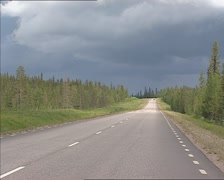 Quiet highway in Swedish landscape, E4 near Porjus - stock footage