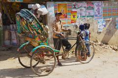 BANDARBAN, BANGLADESH - FEBRUARY 20, 2014: Unidentified rickshaw waits for pa Stock Photos