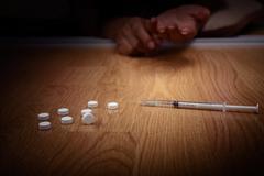 overdose male drug addict hand, drugs narcotic syringe - stock photo