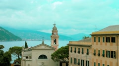 Church and Bell Tower on the Mediterranean coast of Italy Stock Footage