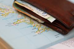 Euro banknotes inside wallet on a geographical map of Reykjavik Stock Photos