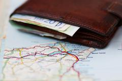 Euro banknotes inside wallet on a geographical map of Tunis Stock Photos