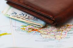 Euro banknotes inside wallet on a geographical map of Palma - stock photo