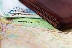 Euro banknotes inside wallet on a geographical map of Dresden Stock Photos