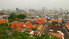 Wat Saket roofs from above, aerial view Bangkok cityscape, from Golden Mount Stock Footage