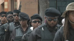 Tight shot of militant African American group walking in Texas - stock footage