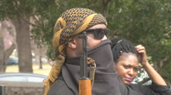 Tight shot of armed militant African American group in Austin, Texas - stock footage