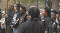 Medium shot of armed militant African American group in Austin, Texas - stock footage