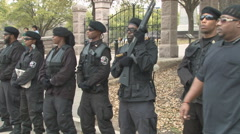 Wide shot of armed militant African American group in Austin, Texas - stock footage