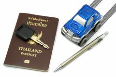 Thailand passport, key, pen and blue 4wd car for travel concept Stock Photos