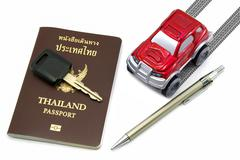 Thailand passport, key, pen and red 4wd car for travel concept Stock Photos
