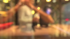 Blurry. People come out of the fastfood restaurant with food Stock Footage