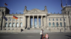Tourist with selfie sticks in front of the Reichstag parliament, Berlin, Germany - stock footage