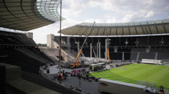 Cranes construct large stage at the Olympic Stadium, Berlin, Germany - stock footage