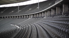 Empty bleachers at Olympic Stadium, Berlin, Germany, shallow DOF Stock Footage