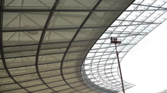 Man on maintenance crane at Olympic Stadium, Berlin, Germany Stock Footage