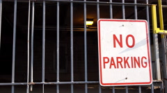 No Parking sign in front of garage 4k Stock Footage