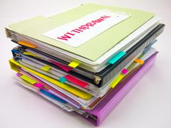 The Pile of Business Documents; Withdrawal - stock photo