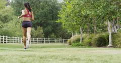 Healthy young Asian woman running slow motion at the park Stock Photos