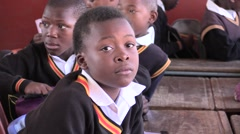 African school kids 010 Young boy in classroom Stock Footage