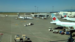 Air Canada airplanes prepare to flight at YVR airport - stock footage