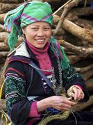 Happy Hmong Woman Dressed in Traditional Attire in Sapa, Vietnam - stock photo