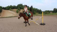 Girl jumping and riding a horse - stock footage
