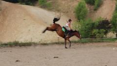 Girl breaks in a horse - stock footage