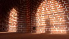 Shadow of a man walking in cloister corridor Stock Footage