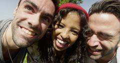 Closeup of three young multiracial friends enjoying the sun - stock photo