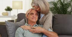 Senior woman comforting husband Stock Photos
