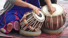 Indian woman playing Indian musical instrument Tabla - stock footage