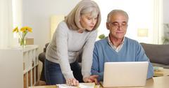 Mature couple doing finances on laptop computer Stock Photos