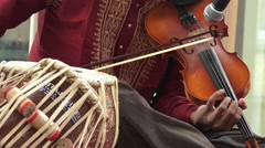 Indian man playing on Violin Stock Footage
