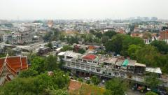 Aerial view sunny low-rise district of Bangkok, panning shot Boripat Road Stock Footage