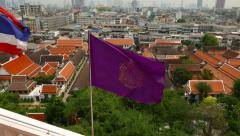 Look out window opening, purple flag flutter on wind against Bangkok cityscape Stock Footage