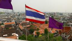 Look out from window opening, seeing thai flag against cityscape outside Stock Footage