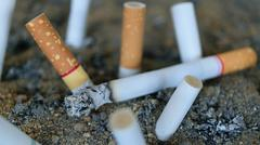 Cigarette burning in ashtray - stock photo