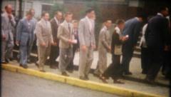 2534 - men then women walk into church - vintage film home movie - stock footage