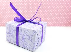 gift box on white and sweet polka dot background - stock photo