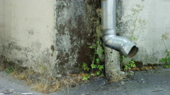 A metal pipe on the corner of a building Stock Footage