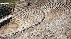 Stock Video Footage of Ancient greek amphitheatre in ruins of Hierapolis city near Pamukkale, Turkey