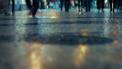 Shot, taken from a low angle, shows a crowd of strolling pedestrians Stock Footage