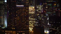 Dramatic Nighttime Cityscape with Brightly Lit Highrise Buildings - stock footage