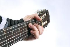 Stock Photo of in the chord playing classical guitar closeup