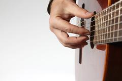 in the chord playing classical guitar closeup - stock photo